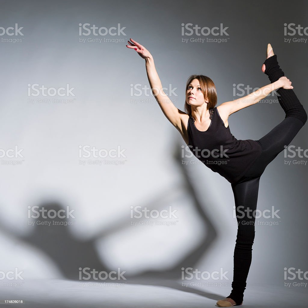 Dancer on gray background looking up royalty-free stock photo