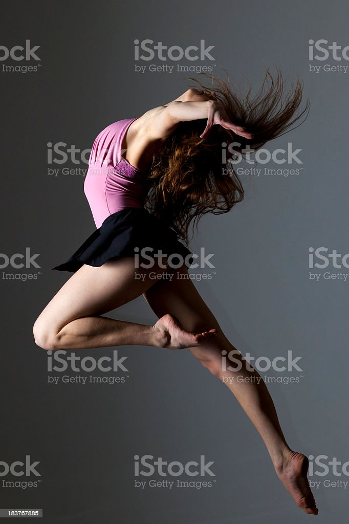 Dancer on grey background royalty-free stock photo