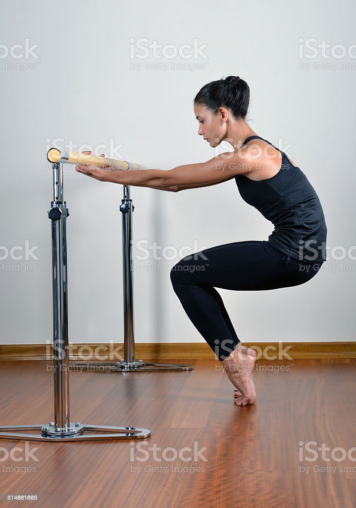 Dancer streching at the barre stock photo
