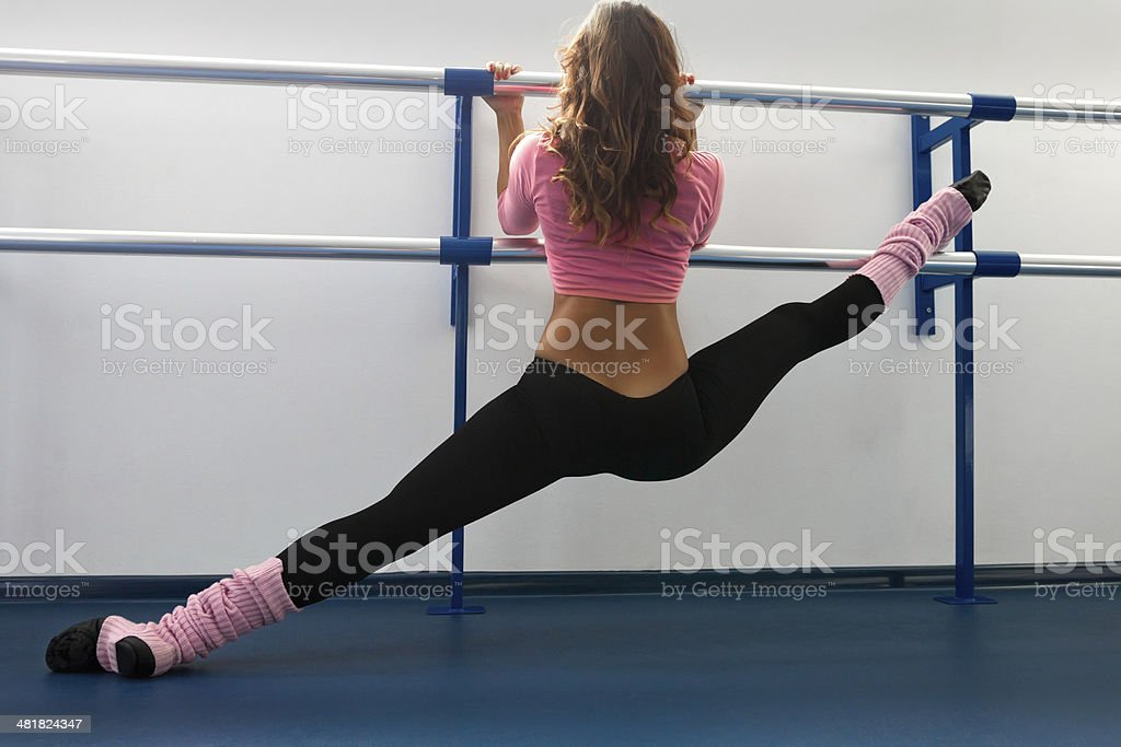 Dancer stretching on bar stock photo