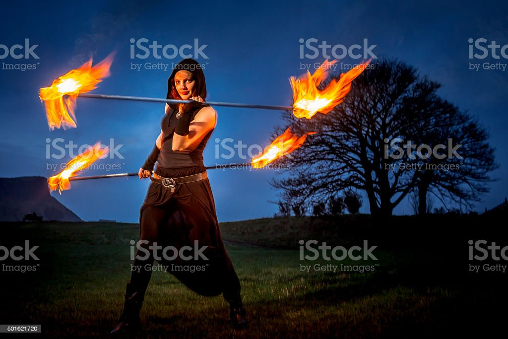 Dancer With Flaming Staffs stock photo