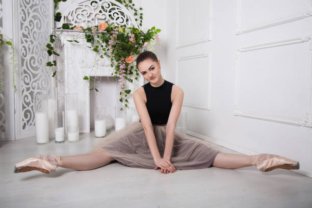 dancer woman sitting in the splits stock photo