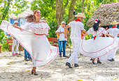 Dancers and musicians perform folk Cuban dance. Captured in Cuba, spring 2018