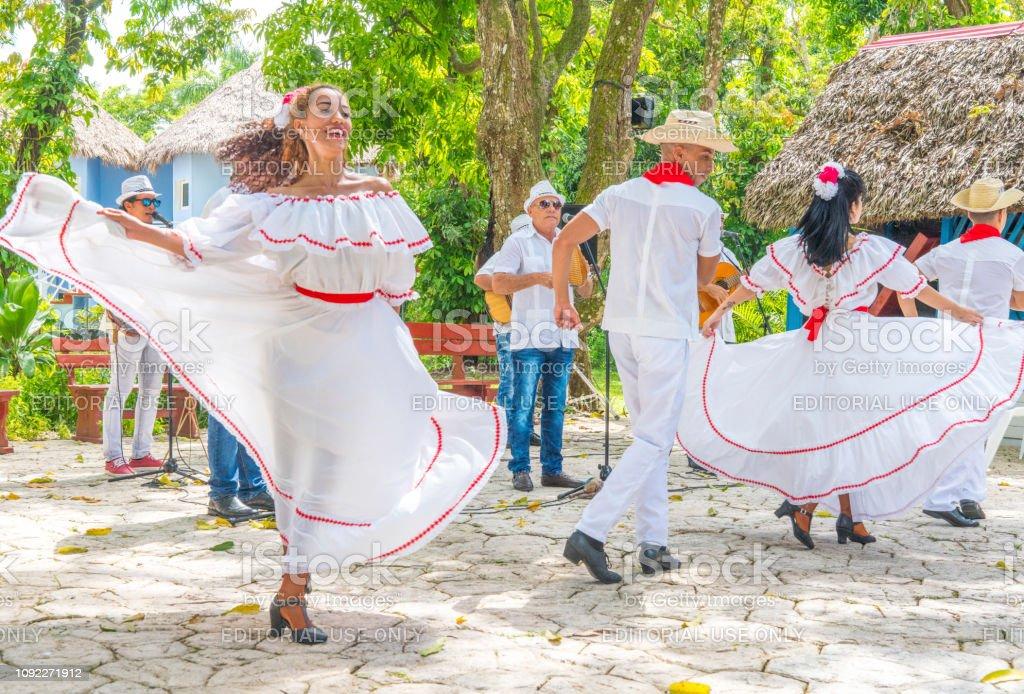 Dancers and musicians perform folk Cuban dance stock photo