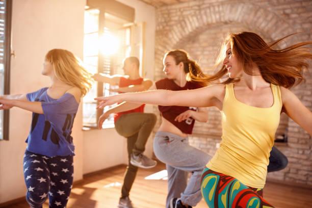 Dancers dancing in dancing studio picture id966172496?b=1&k=6&m=966172496&s=612x612&w=0&h=orx6f3zwndzzfwd6ehijjo7r0jcbji6n ntdqeyakxw=