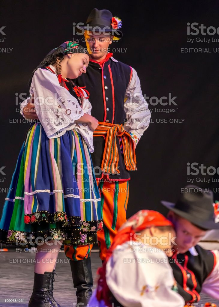 Dancers from Poland in traditional costume, present at the...