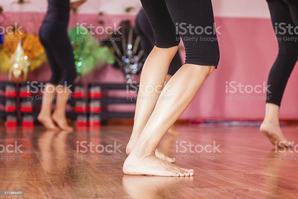 Group of dancers practicing, Focus on legs.