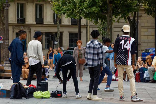 Dancers on Place de Hotel de Ville stock photo