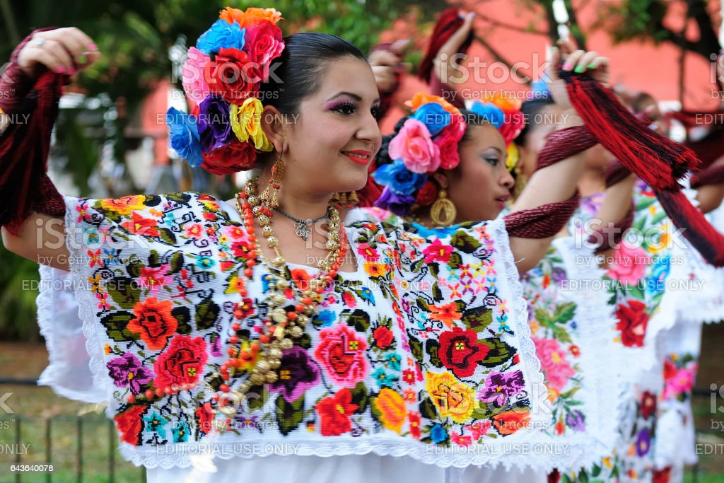 Dancers on streets Mexican in hand-made national costumes