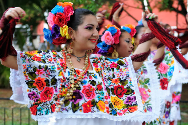 Dancers on streets Mexican in hand-made national costumes stock photo