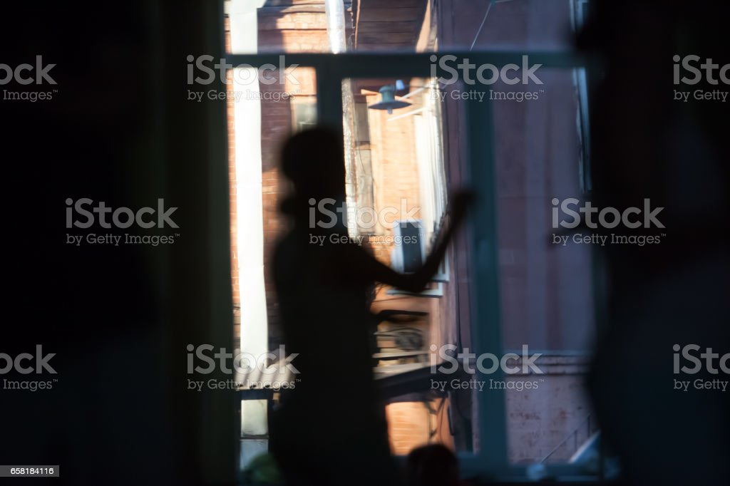 dancers on the background of an open window movement blurred, abstract stock photo