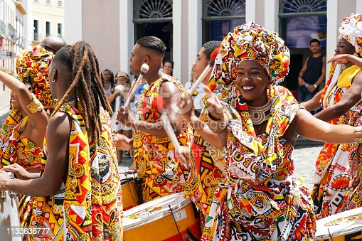 Dancer's small parade with traditional costumes celebrating with revelers the Carnival on the streets. Salvadore, Bahia, Brazil, 02/11/2019