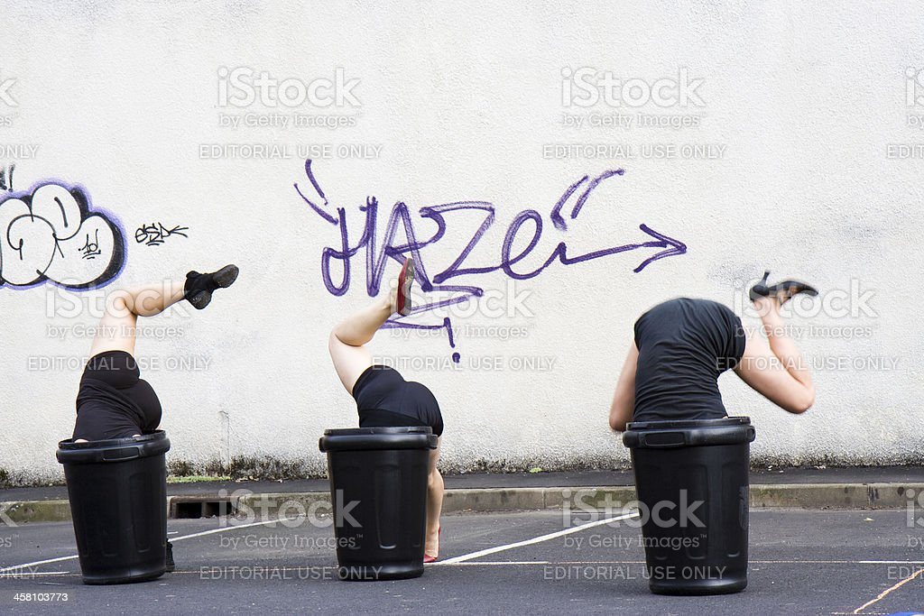 Dancers, the head in garbage can. stock photo