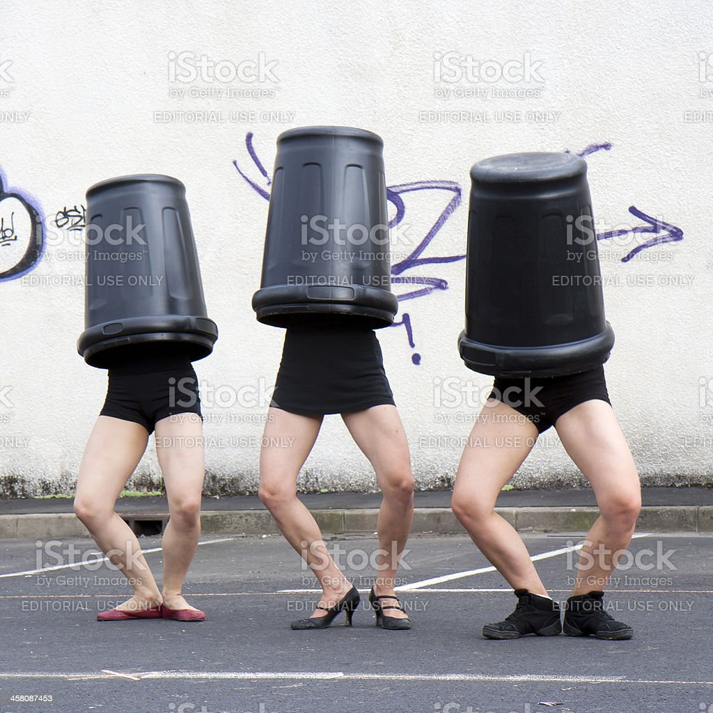 Dancers with garbage cans on the head. royalty-free stock photo