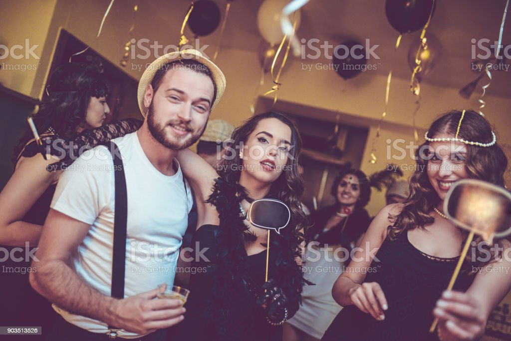 dancing and flirting with speech bubble at new year theme party royalty free stock photo