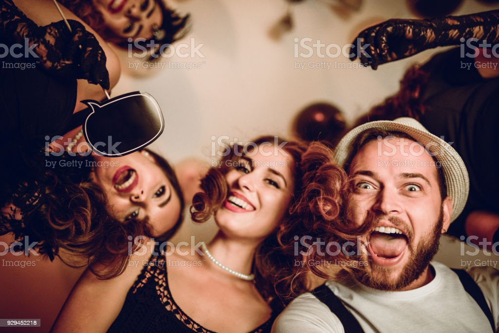 Dancing and Flirting With Speech Bubble at New Year Theme Party stock photo