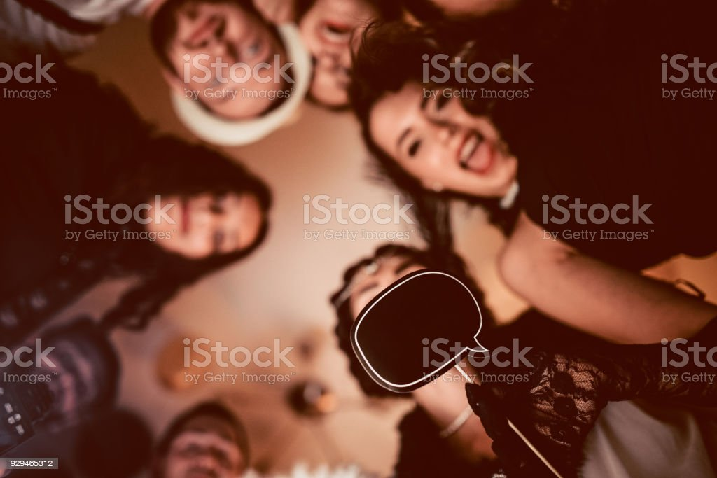 Dancing and Posing With Speech Bubble in the Middle at New Year Theme Party stock photo