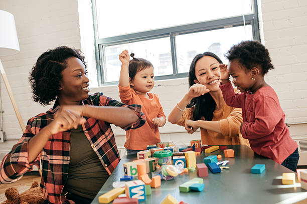 dancing as a part of development - preschool building stock photos and pictures