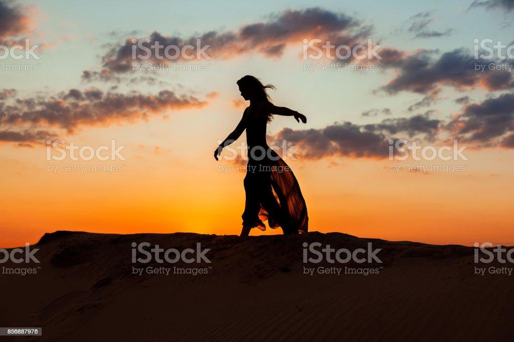 Dancing at night at sunset. stock photo