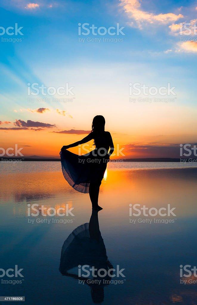 Dancing at sunset stock photo