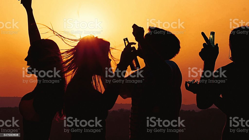Dancing at sunset. stock photo