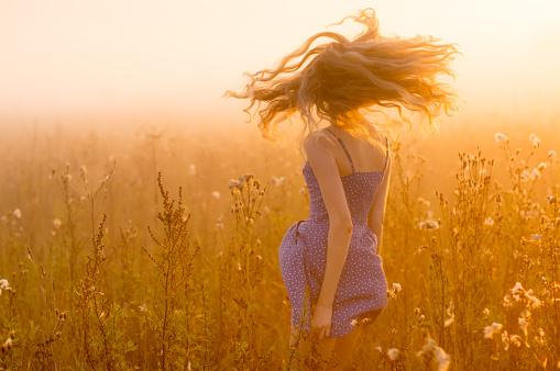 Dancing beautiful girl in fog