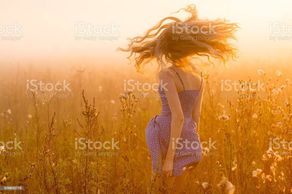 Dancing beautiful girl in fog stock photo
