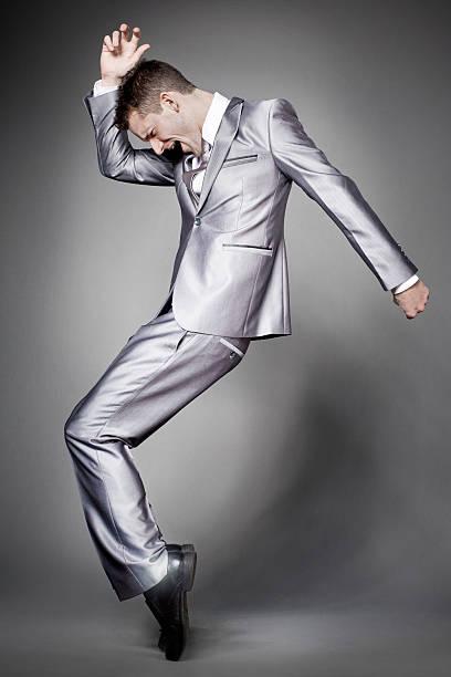 ダンスビジネスマンにエレガントなグレーのスーツです。 ストックフォト