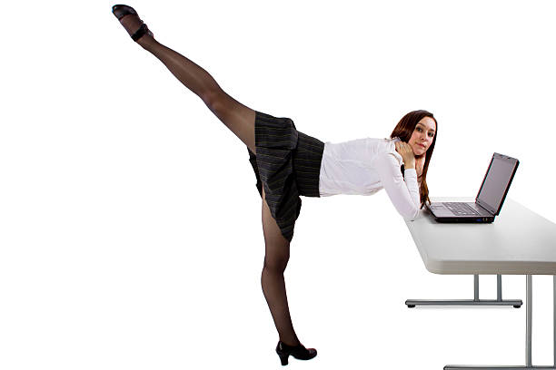 Dancing Businesswoman with a Computer on a White Background stock photo