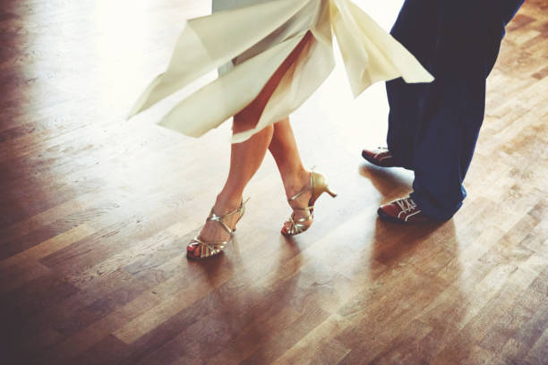 Dancing couple in the light dance hall stock photo