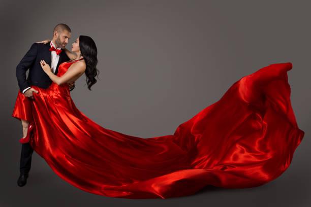dancing couple, woman in red dress and elegant man in suit, flying waving fabric - tango taniec zdjęcia i obrazy z banku zdjęć