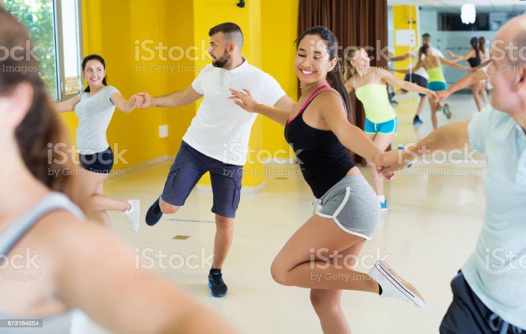 Dancing couples enjoying active swing stock photo