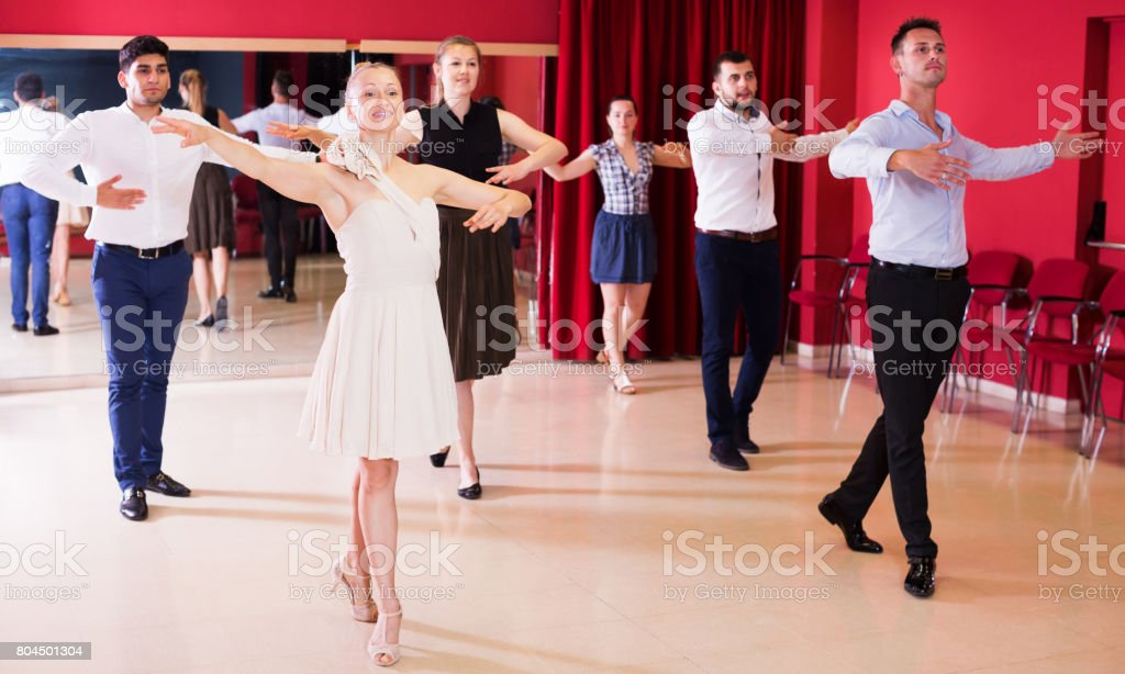 Dancing couples enjoying latin dances stock photo