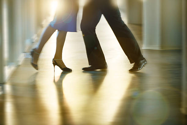 Dancing couples legs in silhouette stock photo