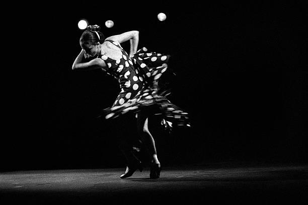 Dancing flamenco lunares stock photo