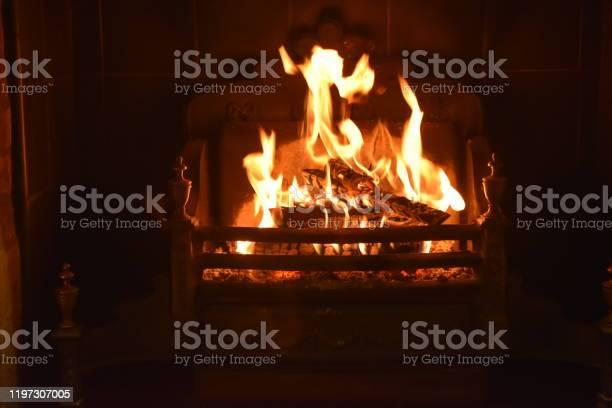 Photo of Dancing flames of a Festive log fire