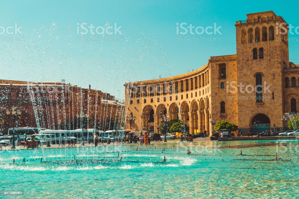 Dancing Fountains and architectural complex on Republic Square. Touristic architecture landmark. Sightseeing in Yerevan. City tour. Government House. Travel and tourism concept. Sunny autumn day. stock photo