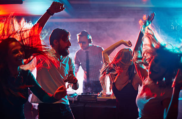 dancing friends - nightclub stock photos and pictures