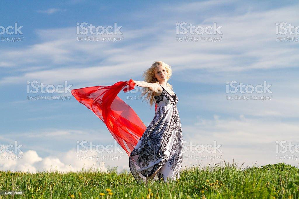 Dancing girl with red scarf, copy space royalty-free stock photo