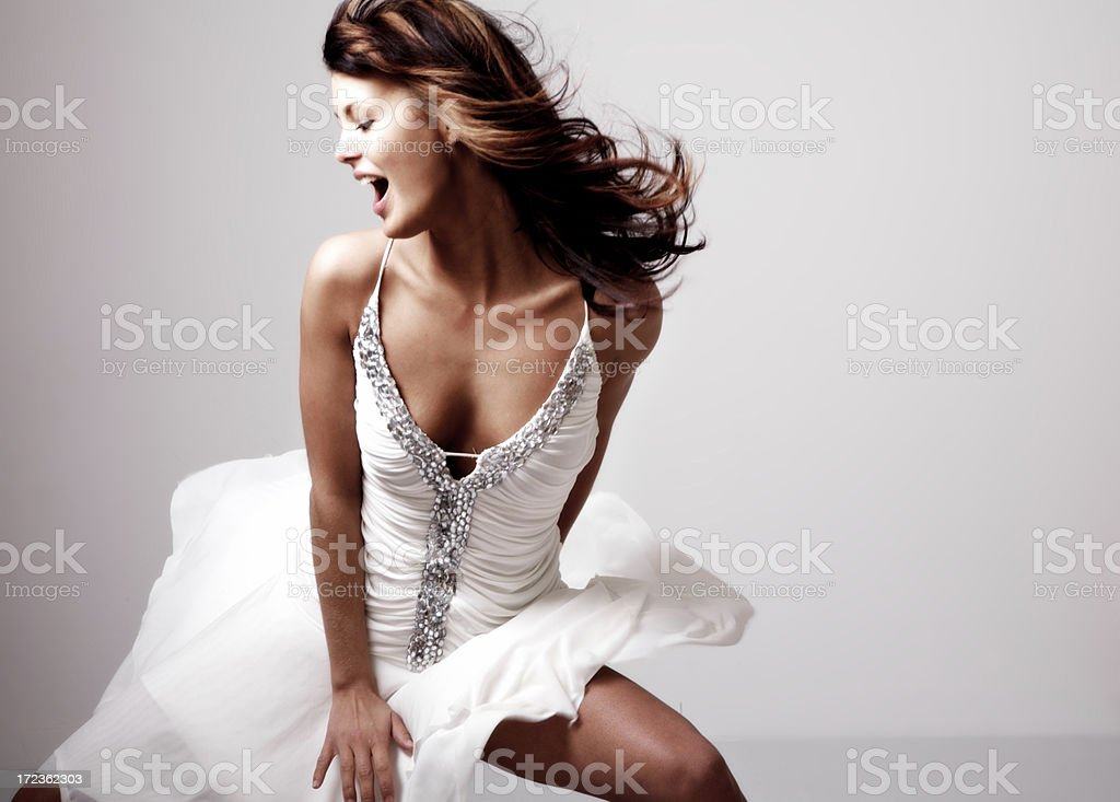 Dancing girl with white robe stock photo