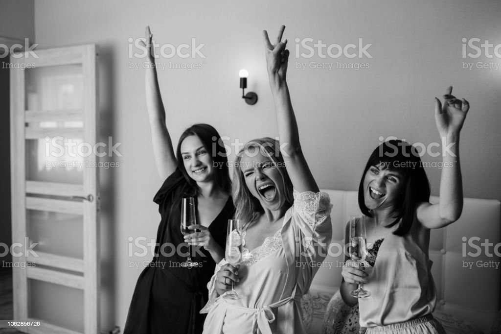 Dancing girls at the hen-party, at home. stock photo