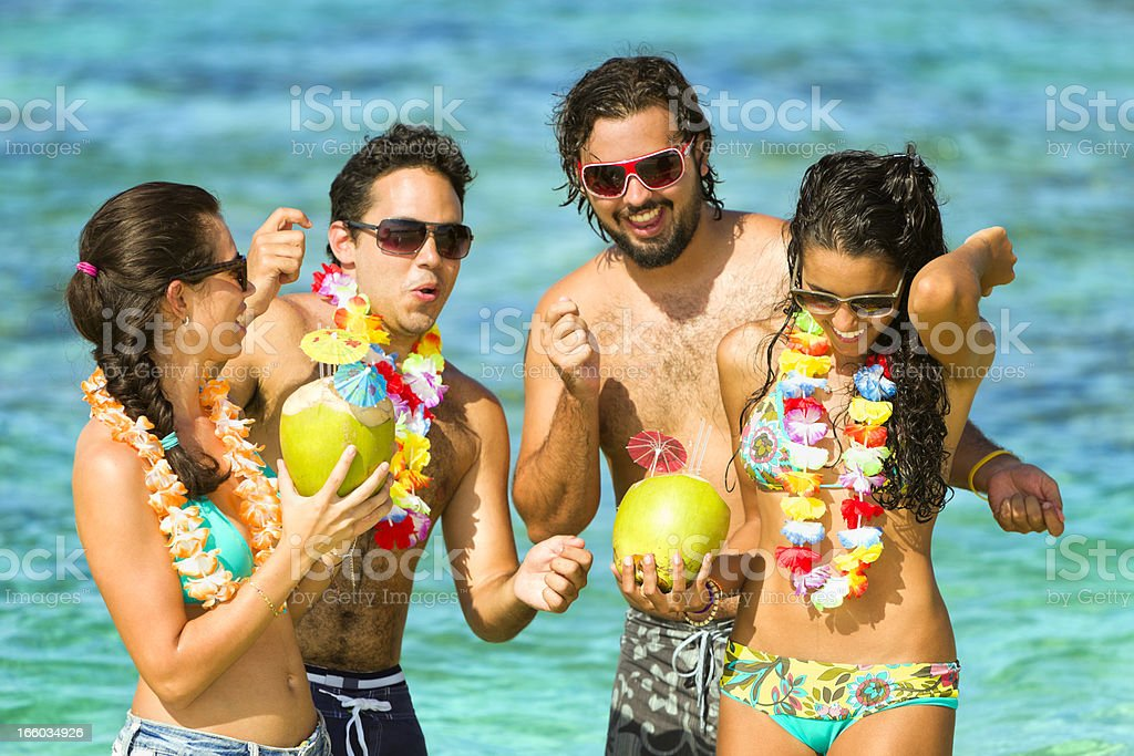 Dancing. Group of young people having fun in tropical beach stock photo