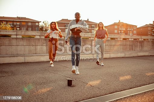 Three young women dancing on the street
