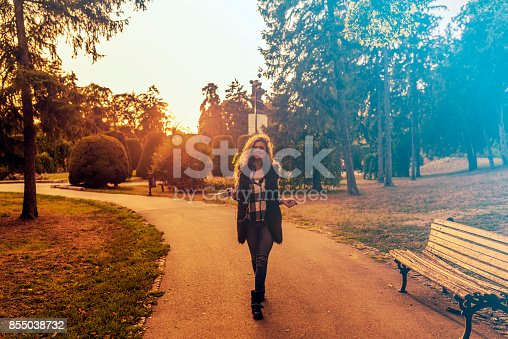 istock Dancing hipster girl with headphones in city during summer 855038732