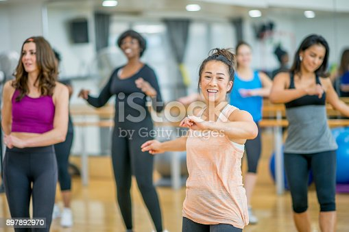 897892972 istock photo Dancing In A Group 897892970