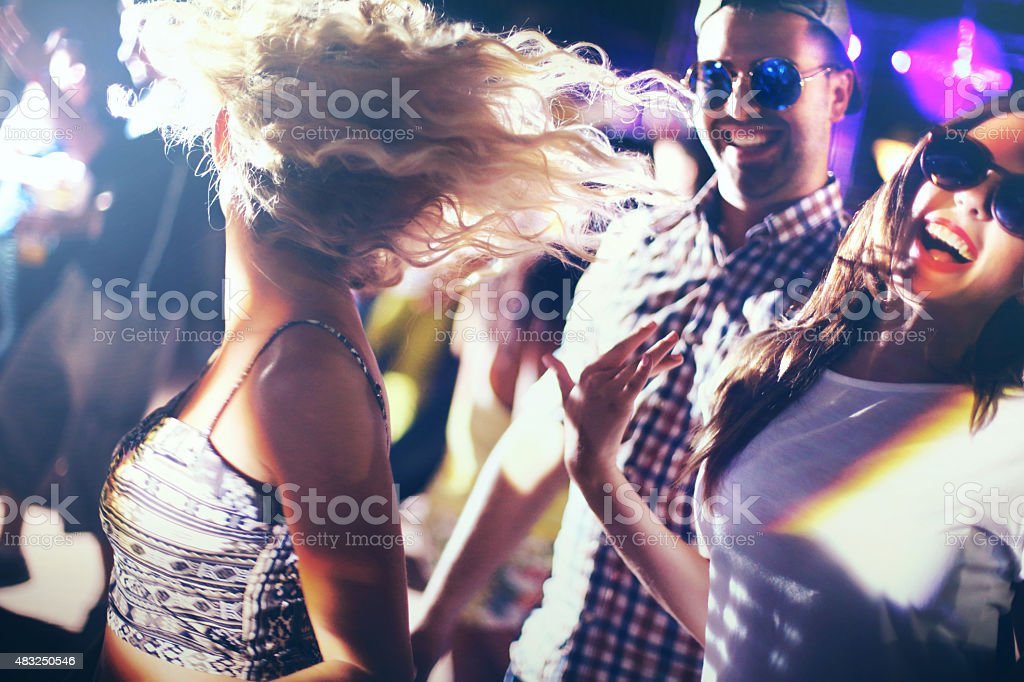Dancing in a nightclub. stock photo