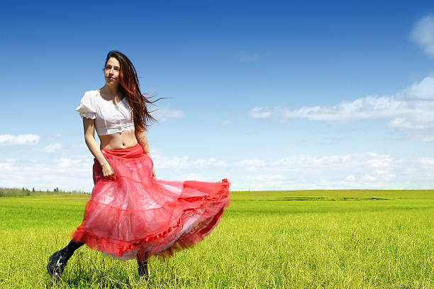 dancing in the meadow - petticoat stock pictures, royalty-free photos & images