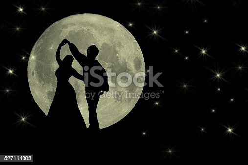 Silhouette of two people dancing in the moonlight
