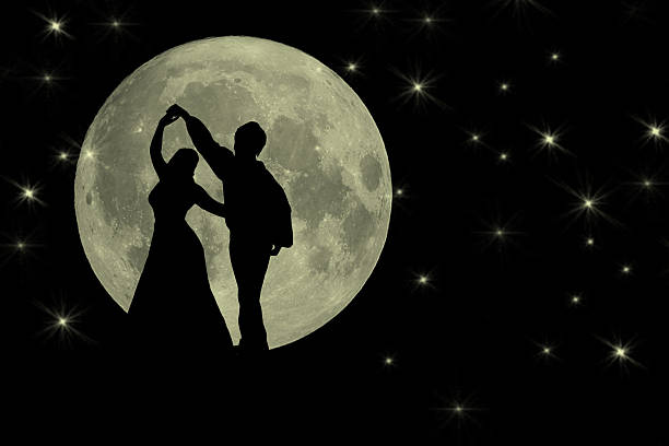 dancing in the moonlight romantic banner - romantic moon stock photos and pictures