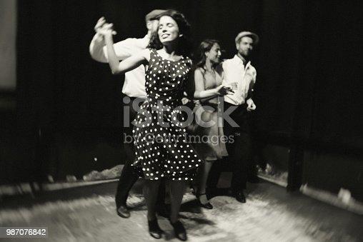 Two beautiful couples dancing shag